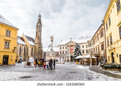 SOPRON, HUNGARY - DECEMBER 16, 2018: The Main Square of Sopron decorated for Christmas and covered in snow