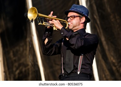 SOPRON, HUNGARY - JUL 2: Jerry di Monza from the Parov Stelar band play on trumpet on the Main stage on the Volt Festival, on Jul 2, 2011 in Sopron, Hungary.