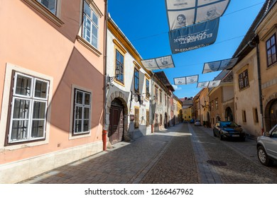 Sopron Hungary Jun 2 2018: Streets of Old Town where people walking along century old buildings.