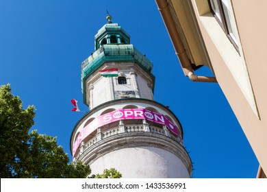 Sopron / Hungary - June 24 2019: Pink Telekom banner of Volt Festival fixed on Firewatch Tower. Flag of Hungary and Sopron.