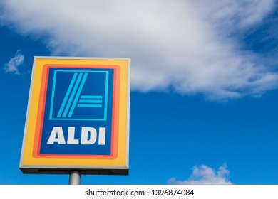 Sopron / Hungary - May 10 2019: Aldi stores logo against cloudy blue sky with copy space