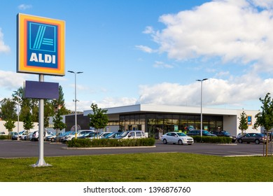 Sopron / Hungary - May 10 2019: Aldi logo and supermarket building with cars parking, copy space