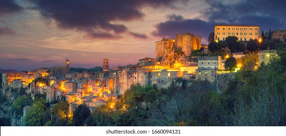Sorano - tuff city in Tuscany. Italy. View in the dusk with illumination, travel background