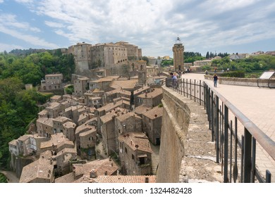 Sorano,Italy-april 29,2018:People visit Sorano, a medieval town in Tuscany during a sunny day.