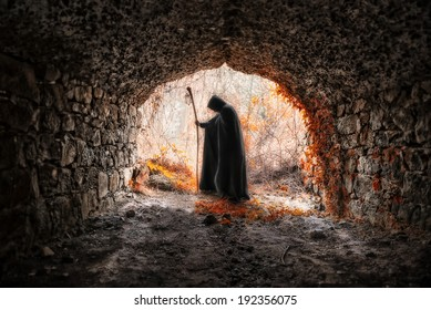 The sorcerer with the robe in a dark cavern