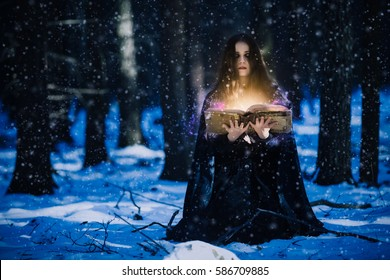 Sorceress celebrating the magic of the magic books