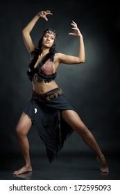 Sorceress woman on dark background