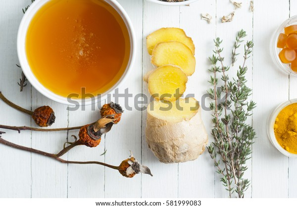 sore throat alternative therapy medicines on bright wooden table background