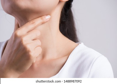 Sore Throat. Closeup Of Beautiful Young Woman Hand Touching Her Ill Neck. Healthcare and medical concept.