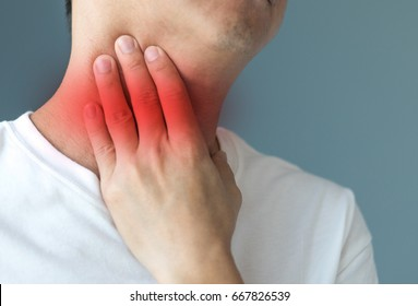 Sore throat healthcare concept. Hand of man touch his neck with red spot as sickness with  pharynx inflammation disease