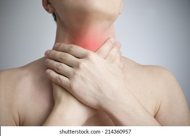 Sore throat of a men. Touching the neck. Red dot.