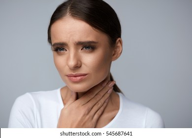 Sore Throat. Sick Woman Feeling Bad Suffering From Throat Pain, Painful Swallowing. Portrait Of Beautiful Ill Girl Caught Cold, Holding Hand On Neck. Illness, Health Concept. High Resolution