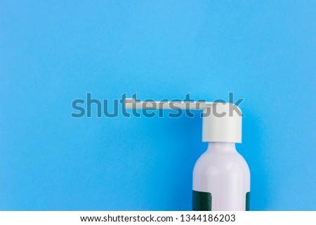 Sore Throat Spray On Blue Background Stock Photo (Edit Now