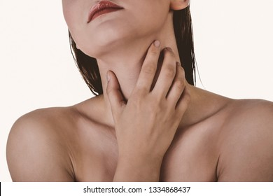Sore throat. Woman touching her neck, isolated on white background.