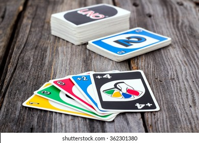 Sorel-Tracy, Canada - January 13, 2016: view of Uno card game on old wood  table. The game was developed by Merle Robbins in Ohio, USA in 1971 it is a Mattel product since 1992.