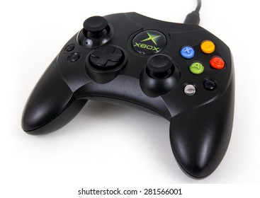 Sorel-Tracy, Canada - May 25, 2015: This is a studio shot of a Microsoft XBOX first generation black game controller isolated on a white background.