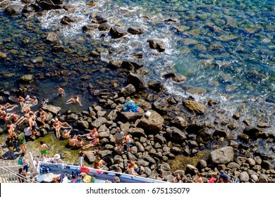 SORGETO, ITALY - MAY 9: people relaxing in Thermal Spring of Sorgeto Bay, Ischia Island, Italy on a hot day of May 9, 2017.