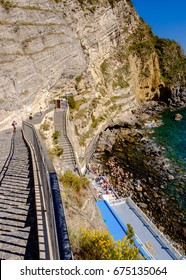SORGETO, ITALY - MAY 9: stairs and beach at Thermal Spring of Sorgeto Bay, Ischia Island, Italy on a hot day of May 9, 2017.