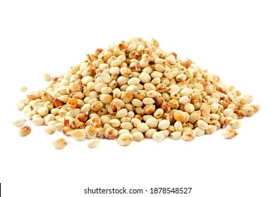 Sorghum seeds isolated on white background. Sorghum Moench on a white background. Sorghum seeds heap isolated on white background. Whole seeds of sorghum, millet, feed.