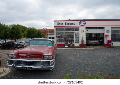 Soro Denmark - September 16. 2017: old vintage car in front of a vintage petrol station and workshop