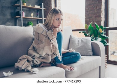 Sorowful minded woman cought a cold, she has running nose and uses paper napkins and mental disorder