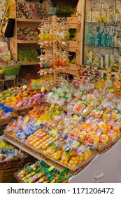 Sorrento, Italy - 2015-06-26 Display of Bright colorful storefront or giftshop selling citrus soaps, candles and other souvenirs