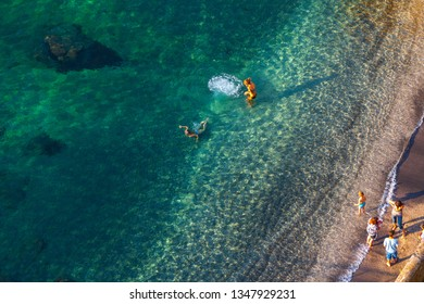 SORRENTO, ITALY -  29 May 2012: Tourists and local residents enjoy at sunny warm evening resting on the sea coast swim in the clean clear sea waters Sorrento, Naples, Campania, Italy.