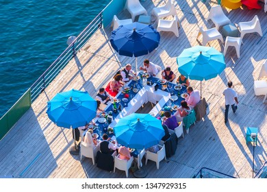 SORRENTO, ITALY -  29 May 2012: Festive wedding dinner at a restaurant on the pier in Sorrento, Naples, Campania, Italy.