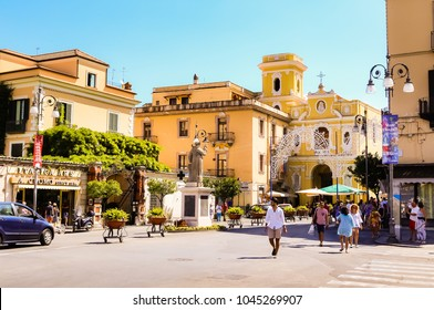 Sorrento, Italy July 16,2017:  Piazza Tasso in Sorrento. Sant Antonio Abate Monument at Central Square in Sorrento, Baroque exterior of the Church of Carmine. Italy