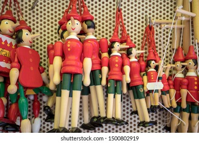 Sorrento, Italy - June 12, 2017: Painted wooden marionette dolls of the figure of Pinocchio  in a souvenir shop in Sorrento. Italy. Pinocchio's long nose symbolized a lie.