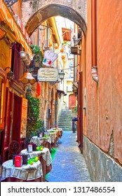 SORRENTO ITALY SEPTEMBER 30 typical restaurants with outdoor tables in the alleys of the historic center September 30 2018 Sorrento Italy