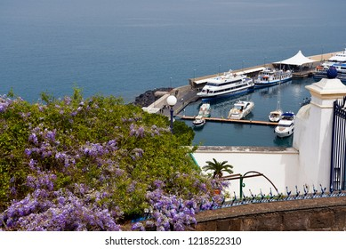 Sorrento,Campania/Italy-April 4th 2018 Sorrento is a small city in Campania, Italy. It is a popular tourist destination. This view from the clifftop of the Marina Piccolo is the ferry port of the town