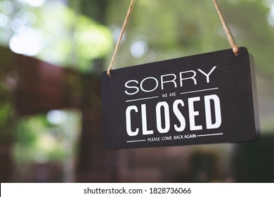 sorry closed sign on shop door. Text on cafe front or restaurant hang on door at entrance. vintage tone style.