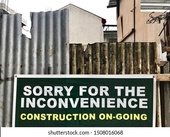 Sorry for the inconvenience, construction is ongoing sign along the street in Makati, Philippines