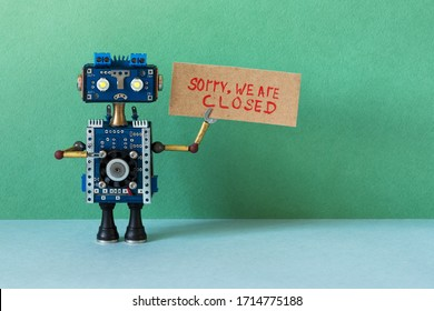 Sorry, we are closed. Crisis bankruptcy or service not available concept. Closed for maintenance  or vacation. Sad robot handyman holds poster with handwritten apologizing message.