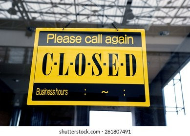 sorry we are closed sign hanging on a window door outside a restaurant, store