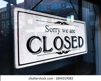 Sorry We Are Closed Sign Hangs In Shop Door