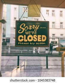 Sorry we are closed sign on fast food glass door