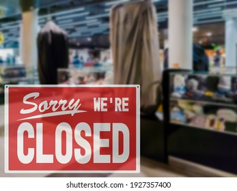 Sorry we are closed sign on the background of empty shopping mall. Covid-19 quarantine concept