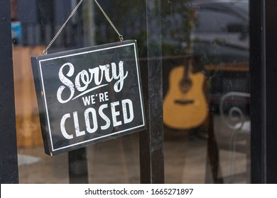 Sorry we're closed sign. grunge image hanging in cafe front