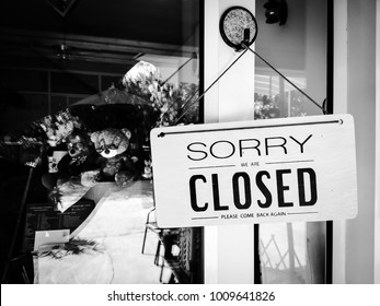 """sorry we're closed sign with text SORRY WE ARE CLOSED PLEASE COME BACK AGAIN"""", black and white tone. can use for business concepts."""