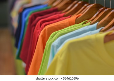 sort of T Shirts are hanging on Clothes Hanger , Colorful T Shirt