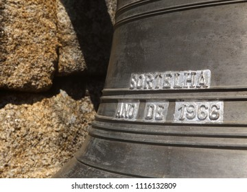 Sortelha, Guarda, Portugal - 06/15/2018: Detail of the village bell tower and bell manufactured in Braga, in Portugal's only remaining factory of its type. Replaced original in 1966.