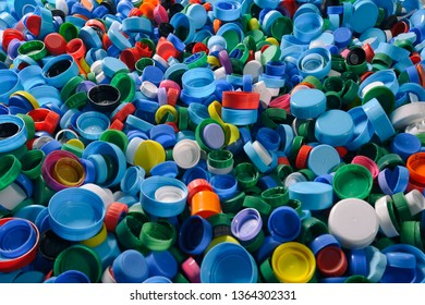 Sorting impressive number of colorful bottle plastic caps spread and ready to be recycled. Close-up of stack .