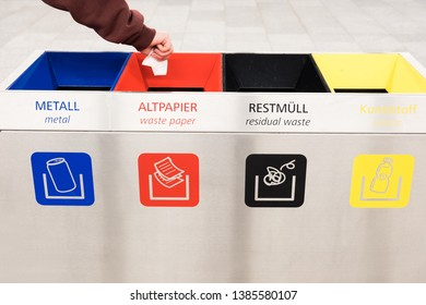 Sorting trash. Man throws paper in the trash bin.