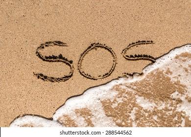 SOS Help Cry For Help On Beach