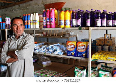 SOSHANGUVE, SOUTH AFRICA - 8 NOVEMBER 2017: A Pakistani shopkeeper in Soshanguve, South Africa. Hundreds of stores and informal trading posts in rural South Africa are owned by Pakistanis. Editorial.