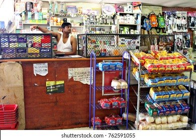 SOSHANGUVE, SOUTH AFRICA - 8 NOVEMBER 2017: A Bangladeshi spaza shop owner in the South African township of Soshanguve. The South African informal sector is worth about $10 billion a year. Editorial.