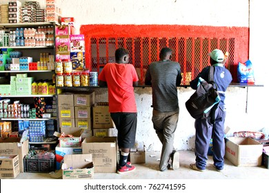 SOSHANGUVE, SOUTH AFRICA - 8 NOVEMBER 2017: Traders concluding a sale in an informal cash-and-carry in Soshanguve. The South African informal sector is worth about $10 billion a year. Editorial.