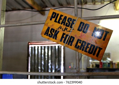SOSHANGUVE, SOUTH AFRICA - 9 NOVEMBER 2017: A sign in an informal spaza shop warns customers not to ask for credit. The SA informal sector is worth about US$10 billion annually. Editorial.